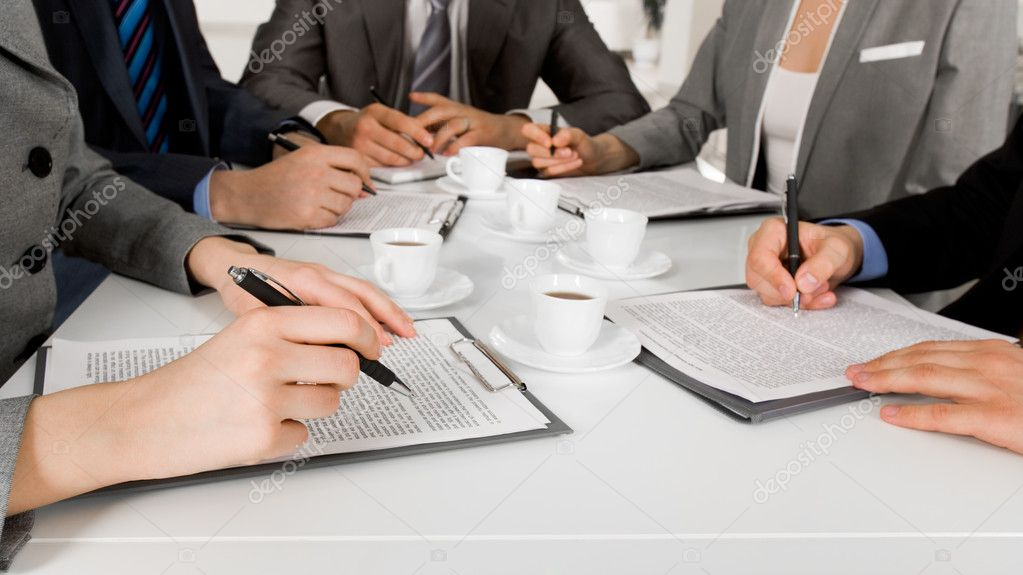 Image of business hands with ballpoints writing on papers while planning work — Stock Photo #11121524