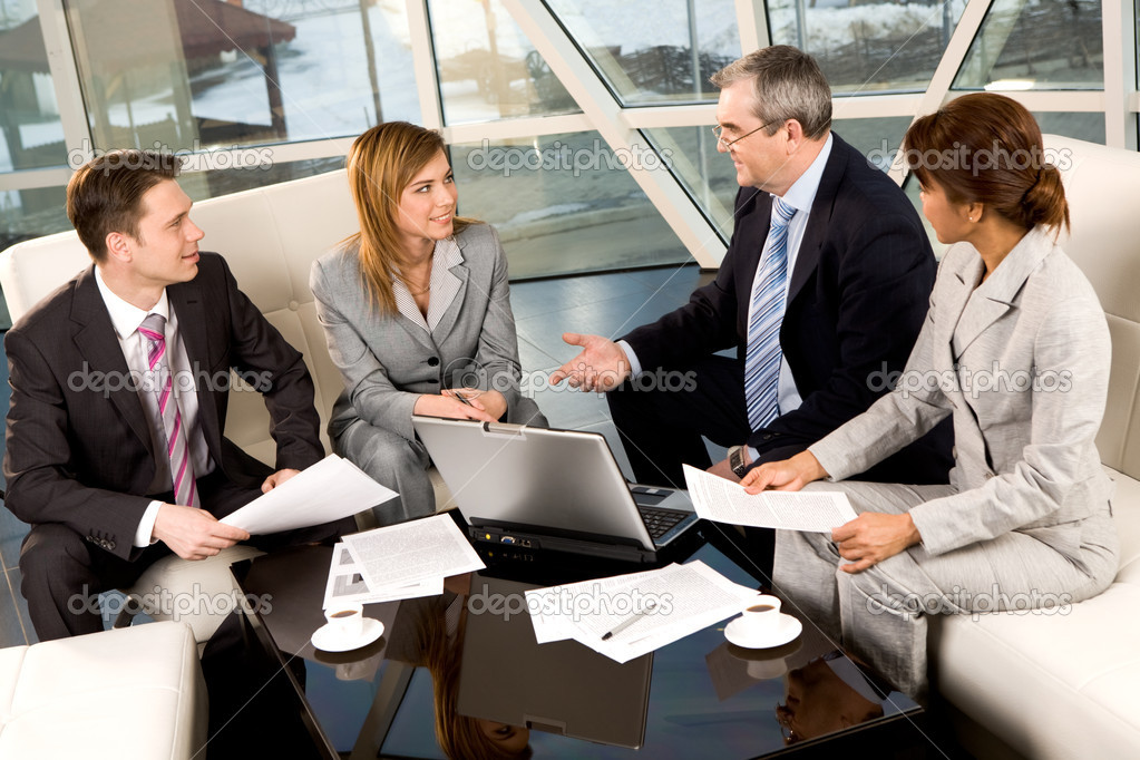 Portrait of confident business partners communicating in office at meeting — Stock Photo #11121599