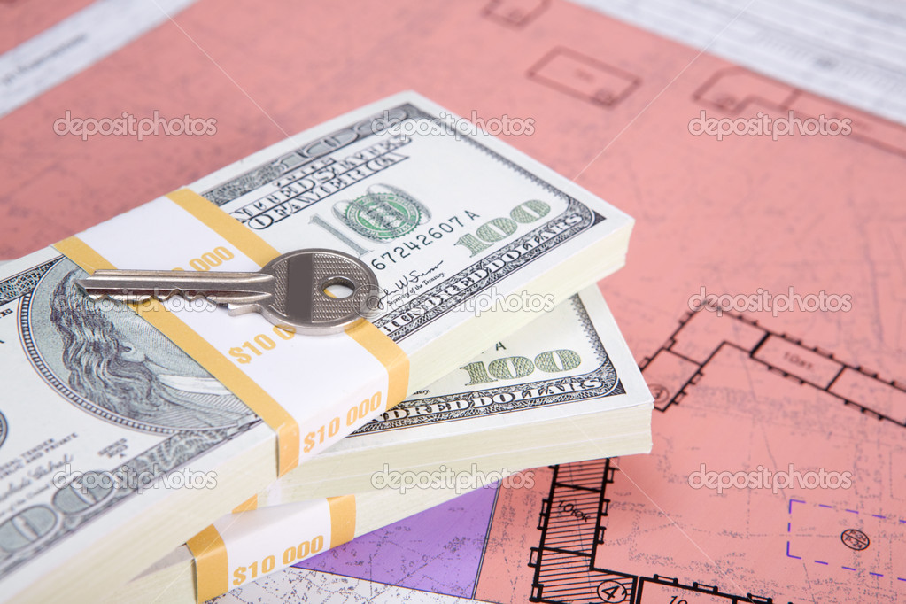 Close-up of pile of dollars with key on its top  Stock Photo #11121697