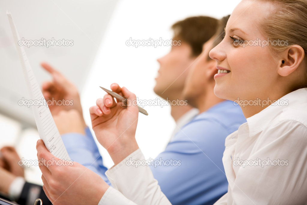 Successful businesswoman reading paper in working environment — Stock Photo #11122534