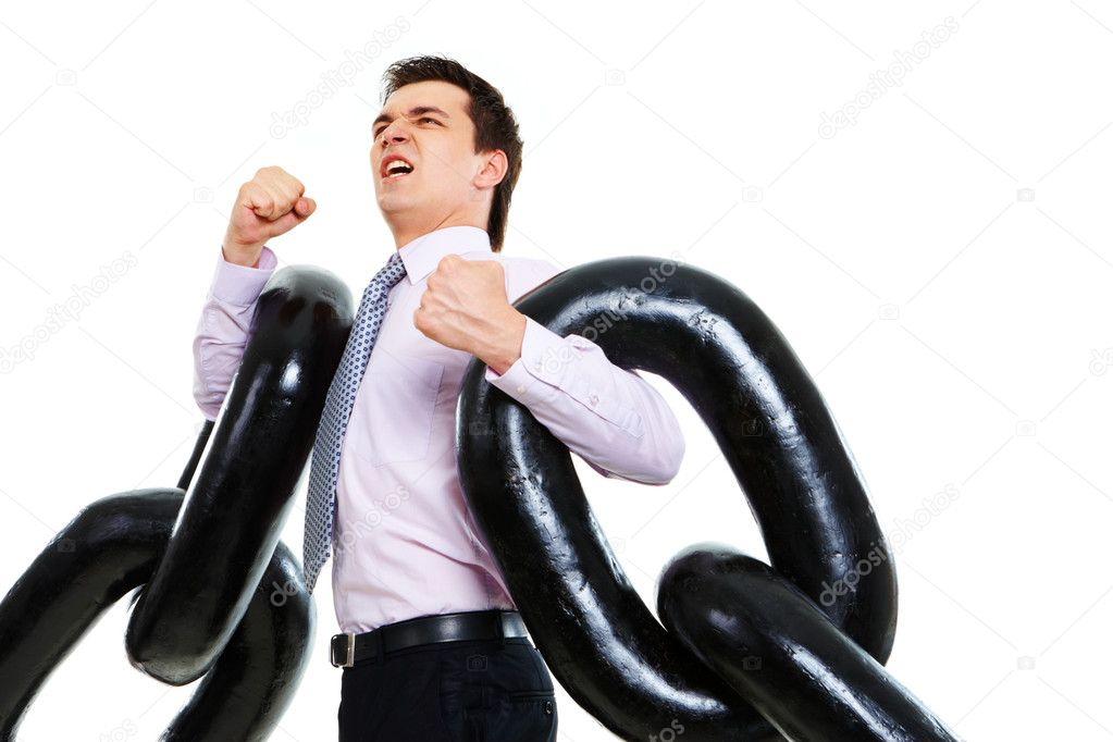 Portrait of tense businessman with two sections of huge chain showing that it is heavy — Stock Photo #11122588