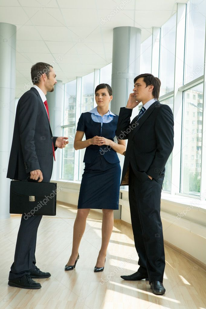 Confident business partners standing in office building and discussing work — Stock Photo #11123263