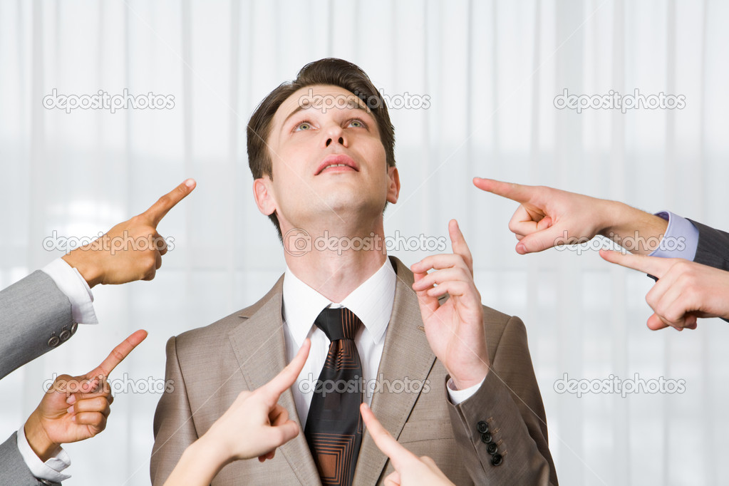 Inquiring businessman pointing upwards surrounded by several forefingers — Stock Photo #11123898