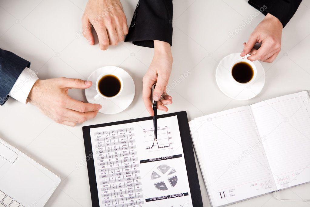 Above view of business hands working with documents at briefing — Stock Photo #11124357