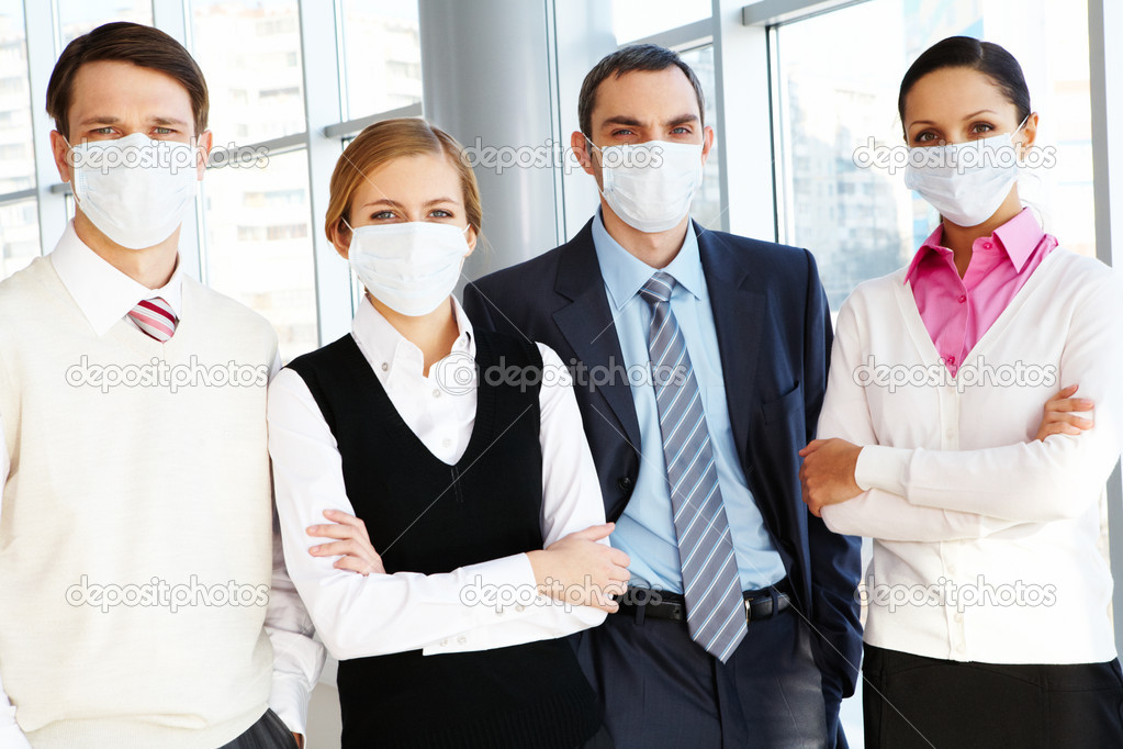 Portrait of business team in protective masks looking at camera — Stock Photo #11124837