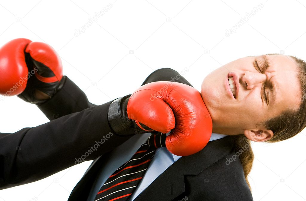 Portrait of defeated businessman in boxing gloves being hit by opponent — Stock Photo #11125026