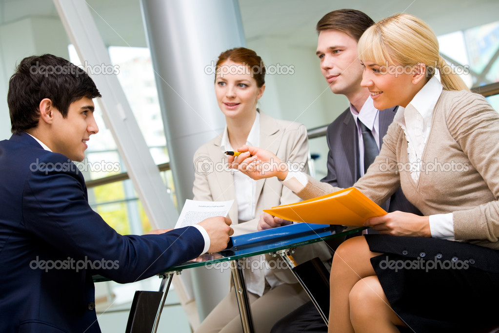 Friendly group of specialists speaking to businessman during negotiations — Stock Photo #11125103