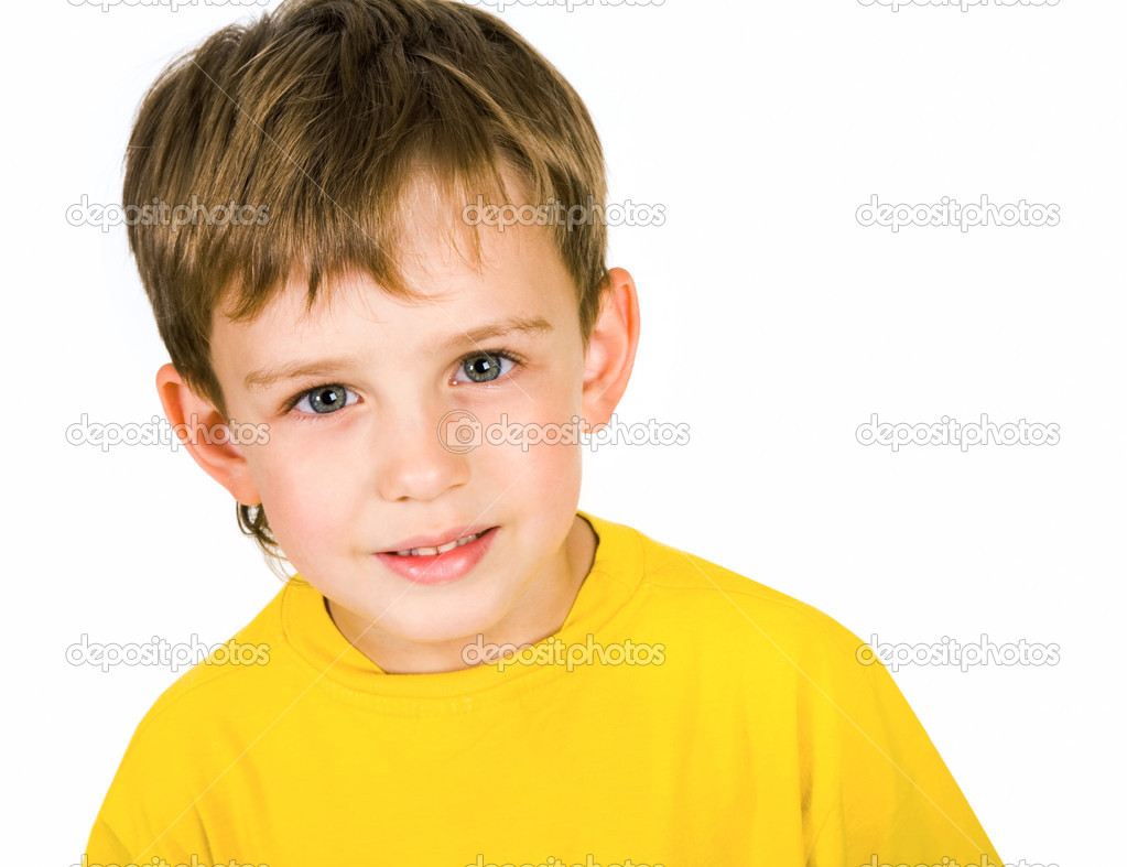 Portrait of boy in yellow shirt isolated on a white background — Stock Photo #11126238