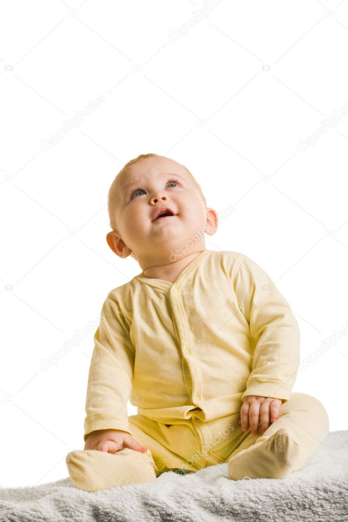 Portrait of sweet child sitting and looking upwards on white background — Stock Photo #11126311