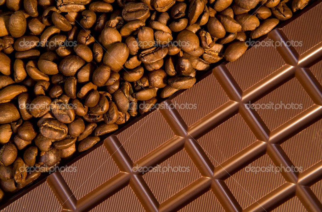 Macro image of dark chocolate bar with heap of coffee grains near by — Stock Photo #11126478