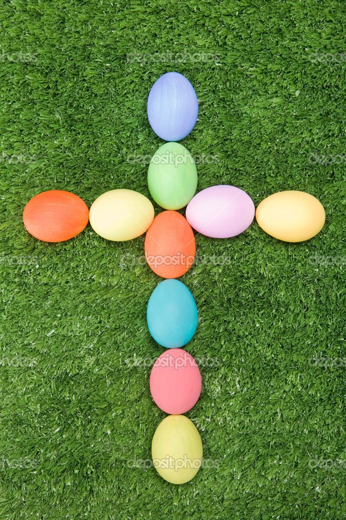 Image of cross made of easter eggs on green grass — Stock Photo #11126855