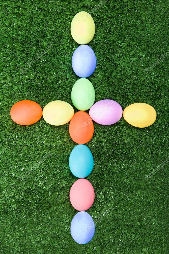 Image of cross made up of Easter eggs on green grass — Stock Photo #11126890