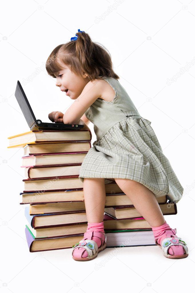Amazed girl of preschool age sitting in front of laptop and looking into its display with open mouth — Stock Photo #11127248