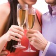 Couple with flutes — Stock Photo