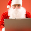 Santa and laptop — Stock Photo