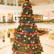 Decorated tree in the trade center — Stock Photo