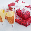 Present and champagne — Stock Photo