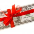 Dollars with red bow — Stock Photo