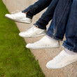 Feet in sportshoes - Stock Photo