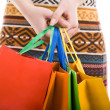 Holding shopping bags — Stock Photo