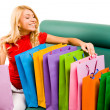 Stock Photo: Looking through shoppingbags