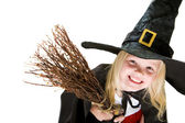 Girl in witch costume — Stock Photo