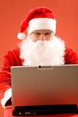 Santa and laptop — Stock Photo