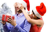 Happy woman closing male's eyes — Stockfoto