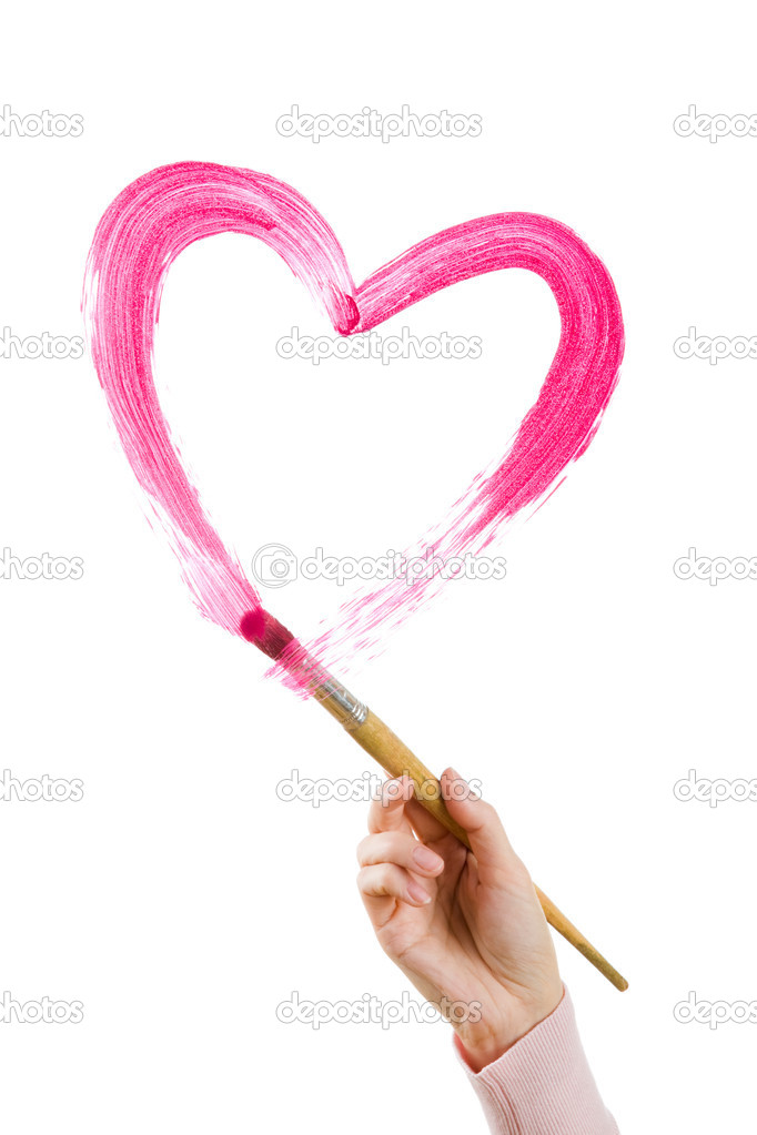 Photo of human hand holding brush and painting shape of heart on white backdrop — Stock Photo #11147306