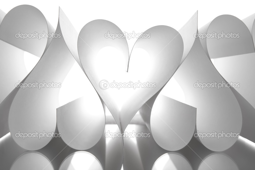 Image of paper sheets making up several heart shapes on white background — Foto Stock #11147312