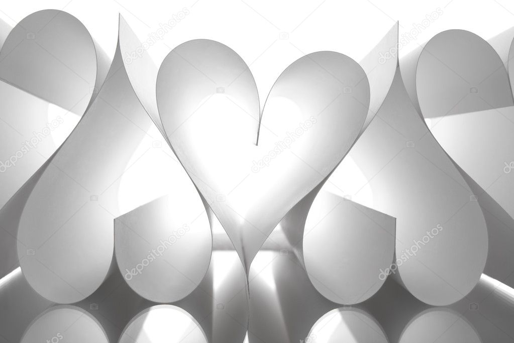 Image of paper sheets making up several heart shapes on white background  Foto Stock #11147312
