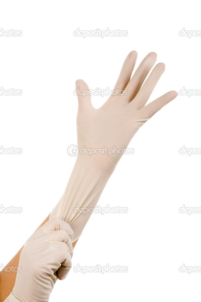 Close-up of hand of surgeon helping to put sterile glove on the other one — Stock Photo #11147543