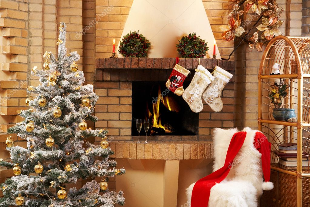 Christmas room with fireplace, chair, presents under decorated fir tree and toys in it  Stock Photo #11148453