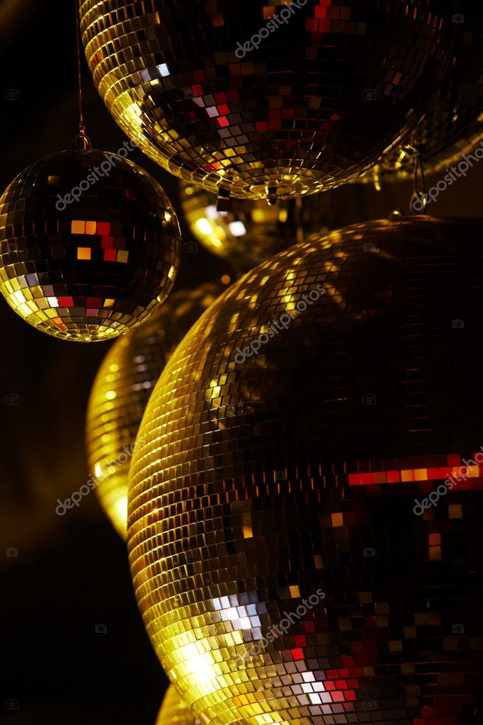 Vertical image of disco balls sparkling in darkness — Stock Photo #11148608
