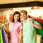 Couple of shopaholics — Stock Photo