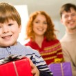 Lad with present - Stockfoto