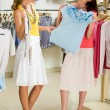 Choosing fashionable clothes - Foto Stock