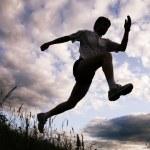 Silhouette of sportsman — Stock Photo