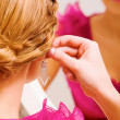 Trying on earrings — Stock Photo