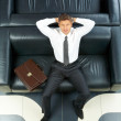Businessman on sofa - Stock Photo