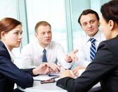 Image of confident colleagues listening to new ideas at meeting — Stock Photo