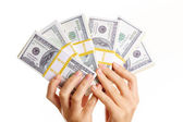 Dollars in hands — Stock Photo