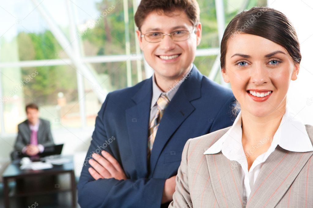 Photo of business woman and businessman in suits looking at camera — Stock Photo #11242002