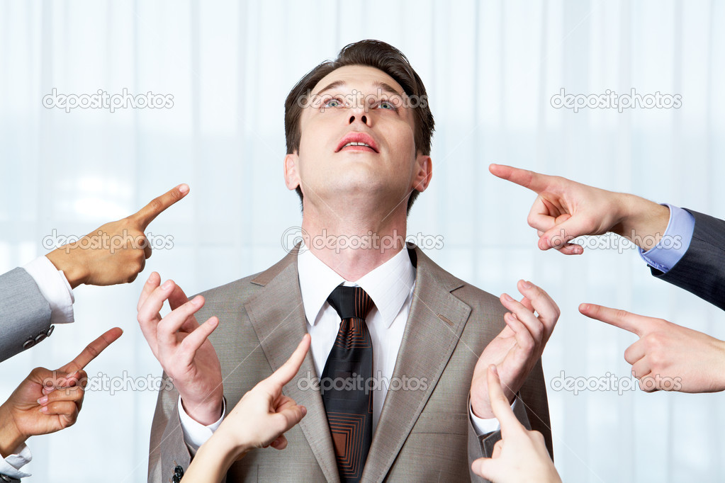 Inquiring businessman pointing upwards surrounded by several forefingers — Stock Photo #11242162