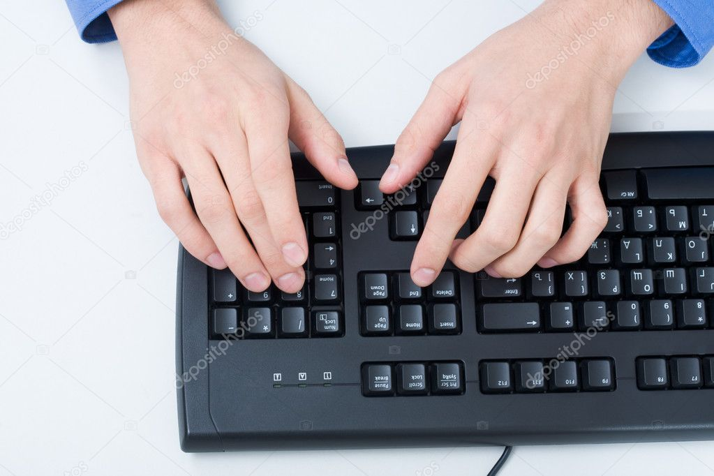 Close-up of male hand touching buttons of black computer keyboard — Stock Photo #11242929