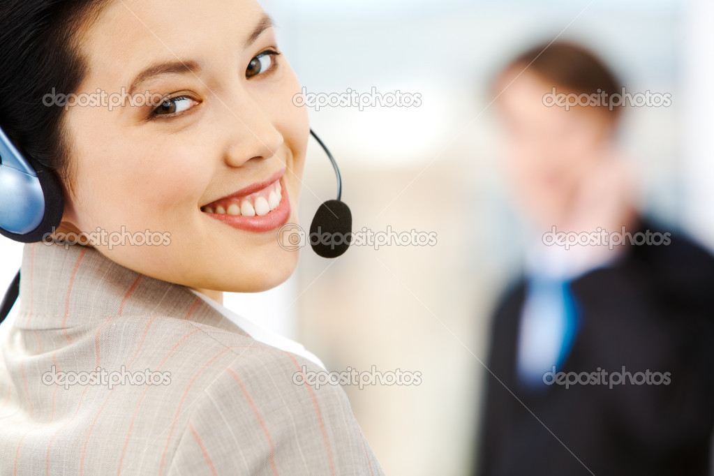 Portrait of attractive customer support service representative wearing headset  Stock Photo #11243187