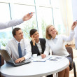 Pointing at whiteboard — Stock Photo