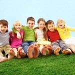 Children on grass — Stock Photo