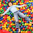 Royalty-Free Stock Photo: Boy on balls
