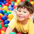 Boy in balls — Stock Photo #11312199